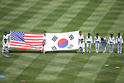 LOS ANGELES, CA - JULY 28:  The Korean National Taekwondo Team holds up United States and Korean flags after performing for fans before the Los Angeles Dodgers game against the Cincinnati Reds on Sunday, July 28, 2013 at Dodger Stadium in Los Angeles, California. The Dodgers won the game in a 1-0 shutout. (Photo by Paul Spinelli/MLB Photos via Getty Images)