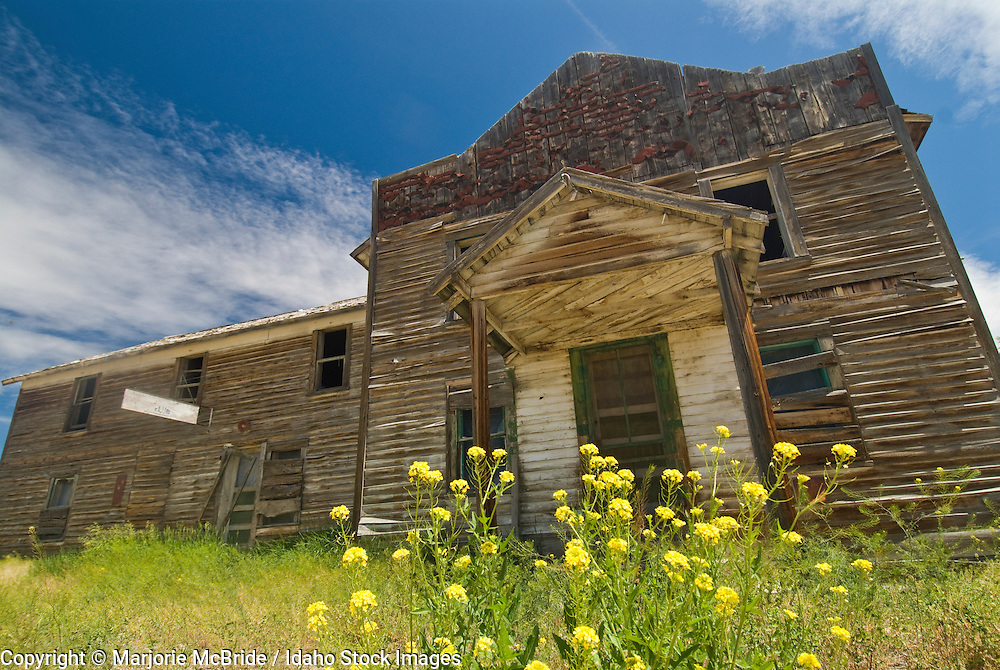Dilapidated old building creates ghost town feel, in May, Idaho.