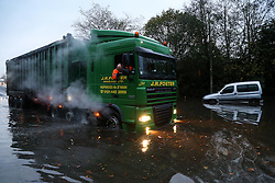 © Licensed to London News Pictures. 22/11/2016. Rotherham, UK. A truck ploughs through a flooded road and past submerged cars in Rotherham, South Yorkshire, after a river broke it's banks last night. Storm Angus has brought heavy wind and rain to much of the UK this week with flooding seen all over. Photo credit : Ian Hinchliffe/LNP