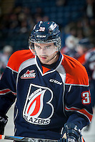 KELOWNA, CANADA - DECEMBER 17: Logan McVeigh #38 of Kamloops Blazers warms up against the Kelowna Rockets on December 27, 2014 at Prospera Place in Kelowna, British Columbia, Canada.  (Photo by Marissa Baecker/Shoot the Breeze)  *** Local Caption *** Logan McVeigh;