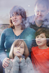 Family Looking out Rainy Window
