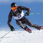 Sam Coffey, USA, in action during the Men's Giant Slalom competition at Coronet Peak, New Zealand during the Winter Games. Queenstown, New Zealand, 22nd August 2011. Photo Tim Clayton