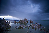 A storm dropping snow on the distant Eastern Sierra and over Mono Lake descends on a late spring day.
