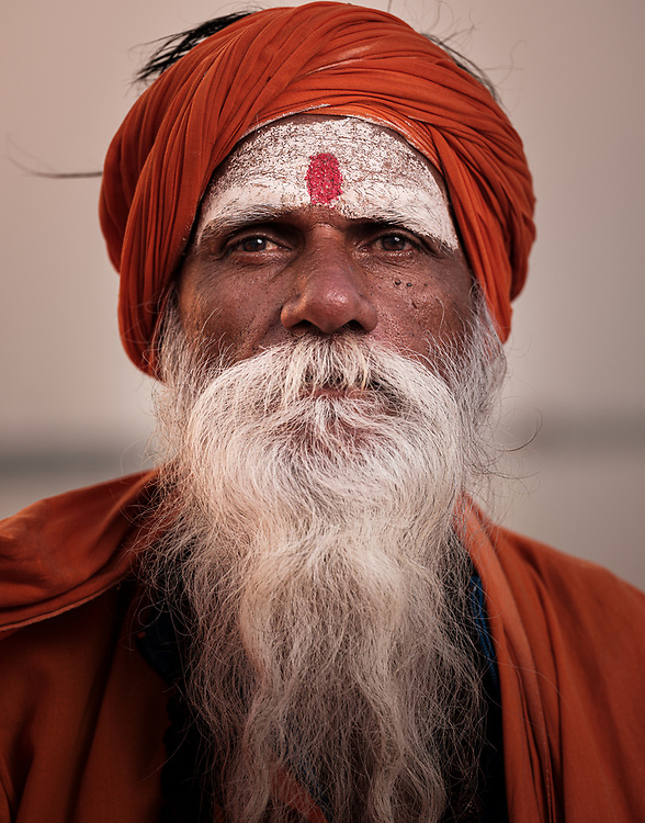 Varanasi, INDIA - CIRCA NOVEMBER 2018: Portrait of a Sadhu in Varanasi. The Sadhus or Holy Man are widely respected in India. Varanasi is the spiritual capital of India, the holiest of the seven sacred cities and with that one the most frequented places for Sadhus.