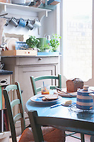 Bread and butter or breakfast table in rural kitchen