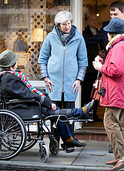 © Licensed to London News Pictures. 04/03/2019. Salisbury, UK. Prime Minister Theresa May talks with shoppers during a visit to Salisbury on the first anniversary of the poisoning of former Russian spy Sergei Skripal and his daughter Yulia in March 2018. They both survived the nerve agent attack but a resident of nearby Amesbury, Dawn Sturgess, died in June 2018 after coming in contact with the poison. Two Russians have been named in connection with the attack. Photo credit: Peter Macdiarmid/LNP