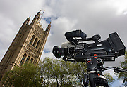 A TV video camera ready to report the 2015 general election, located under the Palace of Westminster in central London.