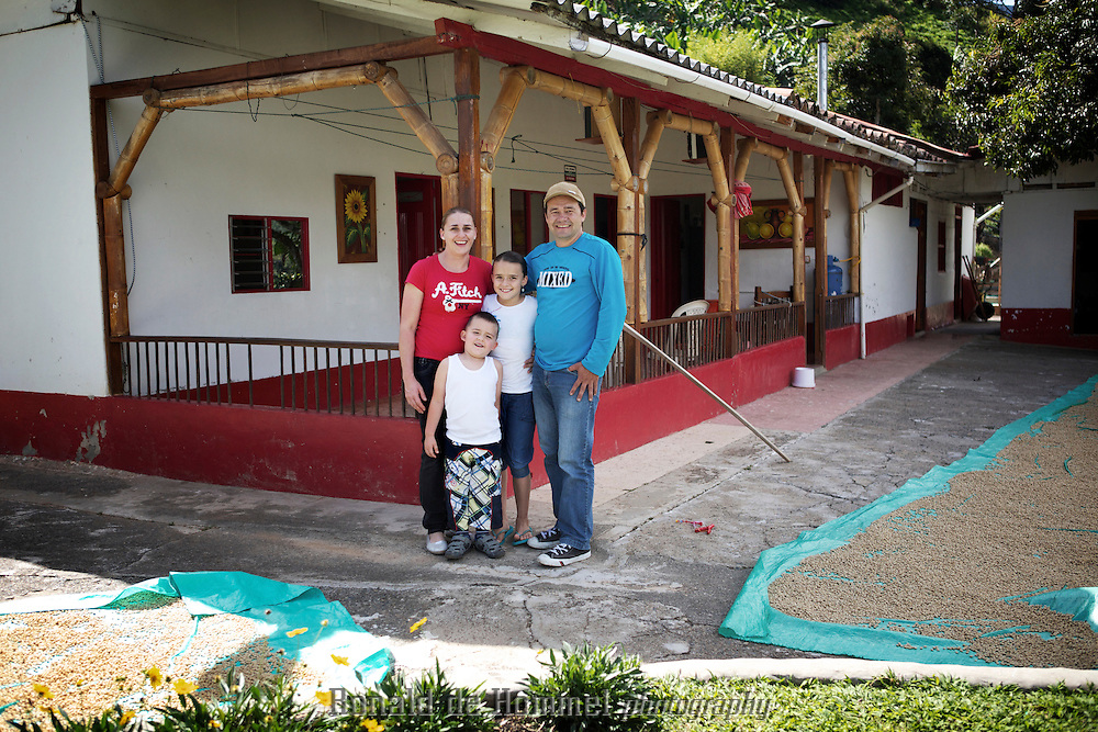 Wilmar Velasquez, his wife Liliana and his two children Dayana and Nicolas in front of their finca San Carlos in the Vereda Las Andes in the municipality of Salgar in southwest Antioquia. The coffee finca of 4 Ha. has been in the family for several generations and Wilmar returned here seven years ago after the family had to flee the violence 20 years ago.