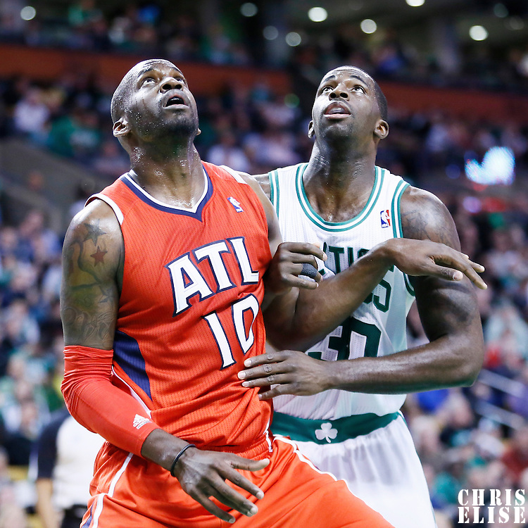 08 March 2013: Atlanta Hawks center Johan Petro (10) vies for the rebound with Boston Celtics power forward Brandon Bass (30) during the Boston Celtics 107-102 OT victory over the Atlanta Hawks at the TD Garden, Boston, Massachusetts, USA.