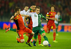 BRUSSELS, BELGIUM - Tuesday, October 15, 2013: Wales' captain Aaron Ramsey in action against Belgium during the 2014 FIFA World Cup Brazil Qualifying Group A match at the Koning Boudewijnstadion. (Pic by David Rawcliffe/Propaganda)