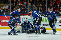 KELOWNA, CANADA - FEBRUARY 12:  Erik Gardiner #12 of the Kelowna Rockets falls to the ice after taking a shot on Griffen Outhouse #30, while Kade Jensen #21 and Tanner Kaspick #16 defend and Matthew Phillips #11 of the Victoria Royals clears the puck away on February 12, 2018 at Prospera Place in Kelowna, British Columbia, Canada.  (Photo by Marissa Baecker/Shoot the Breeze)  *** Local Caption ***