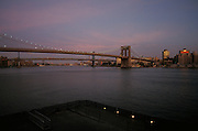 Night time view from Pier 17 of the Brooklyn Bridge NYC