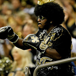 September 25, 2011; New Orleans, LA, USA; A New Orleans Saints fan in the stands during the fourth quarter of a game against the Houston Texans at the Louisiana Superdome. The Saints defeated the Texans 40-33. Mandatory Credit: Derick E. Hingle