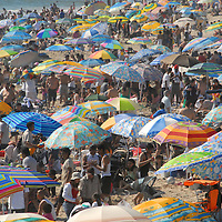 A sea of umbrellas invade the Santa Monica Coastline on Sunday, April 13, 2008. Temperatures reached 93 degrees along the coast on Sunday.