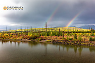 Double Rainbow over The North Fork of the Flathead River in early autumn in Glacier National Park, Montana, USA