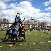 Action from the Washington V NYPD (blue) rugby match during the Four Leaf 15's Club Rugby Tournament at Randall's Island New York. The tournament included 70 teams in 6 divisions, organized by the New York City Village Lions RFC. Randall's Island, New York, USA. 23rd March. Photo Tim Clayton