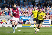 Aston Villa midfielder Mile Jedinak (25) chases Burton Albion midfielder Michael Kightly (28) during the EFL Sky Bet Championship match between Burton Albion and Aston Villa at the Pirelli Stadium, Burton upon Trent, England on 8 April 2017. Photo by Richard Holmes.