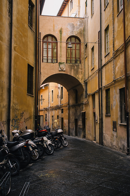 Street scenes of Pisa - scooters parked in an alley, Italy