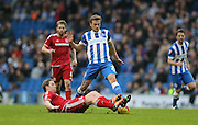 Brighton striker (on loan from Manchester United), James Wilson (21) tackled by Middlesbrough FC defender Ben Gibson during the Sky Bet Championship match between Brighton and Hove Albion and Middlesbrough at the American Express Community Stadium, Brighton and Hove, England on 19 December 2015.