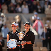PARIS, FRANCE June 08.  Winner Ashleigh Barty of Australia and runner up Marketa Vondrousova of the Czech Republic with their trophies on Court Philippe-Chatrier after the Women's Singles Final match at the 2019 French Open Tennis Tournament at Roland Garros on June 8th 2019 in Paris, France. (Photo by Tim Clayton/Corbis via Getty Images)