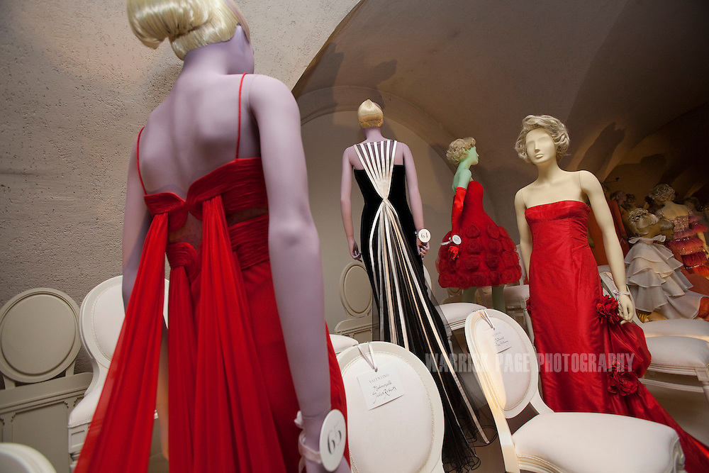 Dress worn by Julia Roberts (2-L) and Jennifer Aniston (2-R) are seen at the 'Valentino: Master of Couture' exhibition at Somerset House on November 28, 2012 in London, United Kingdom. Celebrating the life and work of the Italian master couturier, the show features over 130 hand crafted designs worn by Hollywood icons and Royalty. The exhibition runs from November 29, 2012 - March 3, 2013. (Photo by Warrick Page)