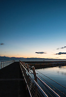 The breakwater off the southern shore of Victoria, BC is a popular spot to walk at sunset.