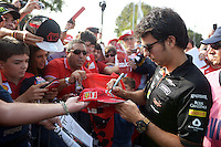 Sergio Perez (MEX) Sahara Force India F1 signs autographs for the fans.<br /> Italian Grand Prix, Sunday 7th September 2014. Monza Italy.