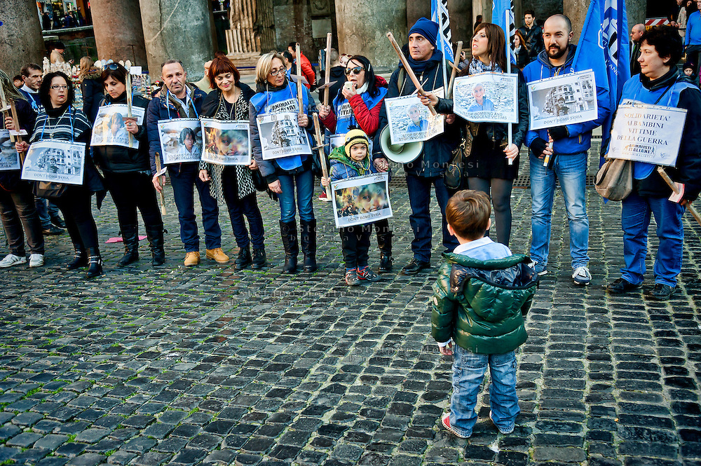 On the occasion of the World Day of Social Justice, The Honeysuckle Onlus and Animalisti Italian Onlus reminded the children of Syria and children victims of all wars, asking stop bombing,  lighting a candle to the Pantheon, Rome, Italy. 20th February 2016