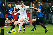 Edin Dzeko of AS Roma vies with Milan Skriniar, Roberto Gagliardini of Inter during the Italian championship Serie A football match between FC Internazionale and AS Roma on January 21, 2018 at Giuseppe Meazza stadium in Milan, Italy - Photo Morgese - Rossini / ProSportsImages / DPPI