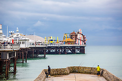 © Licensed to London News Pictures. 16/11/2019. Brighton, UK. Dark clouds hang over the Brighton Palace Pier as weather in Brighton and Hove has turned colder with occasional rain showers. Photo credit: Hugo Michiels/LNP