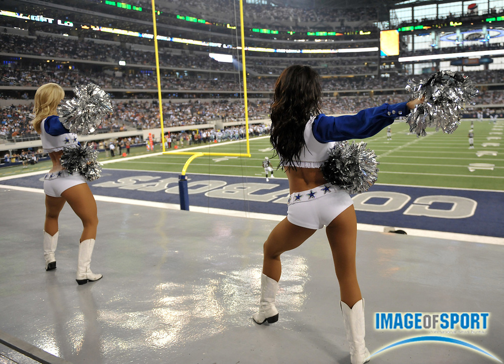 Aug 12, 2010; Arlington, TX, USA; Dallas Cowboys cheerleaders perform during the game against the Oakland Raiders at Cowboys Stadium. Photo by Image of Sport
