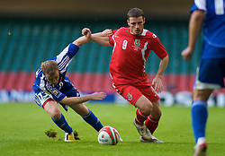CARDIFF, WALES - Saturday, October 11, 2008: Wales' Jason Koumas and Liechtenstein's Martin Buchel during the 2010 FIFA World Cup South Africa Qualifying Group 4 match at the Millennium Stadium. (Photo by Gareth Davies/Propaganda)