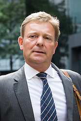 © Licensed to London News Pictures. 15/08/2017. LONDON, UK.  CRAIG MACKINLAY, Conservative MP for South Thanet leaving Southwark Crown Court after a Plea and Trial Preparation Hearing (PTPH). CRAIG MACKINLAY, Conservative MP for South Thanet, MARION LITTLE, Craig Mackinlay's campaign director and NATHAN GRAY, Craig Mackinlay's election agent have each been charged with offences under the Representation of the People Act 1983.  Photo credit: Vickie Flores/LNP