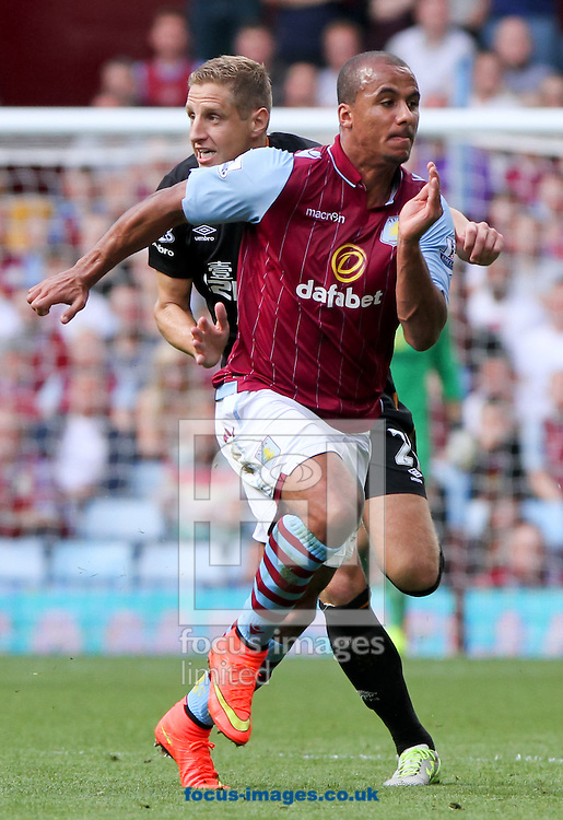 Andreas Weimann (front) of Aston Villa and Michael Dawson (back) of Hull City during the Barclays Premier League match at Villa Park, Birmingham<br /> Picture by Tom Smith/Focus Images Ltd 07545141164<br /> 31/08/2014