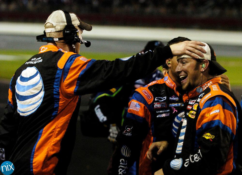 Jeff Burton's crew celebrates their Bank of America 500 win at Lowe's Motor Speedway Saturday Oct. 11, 2008.