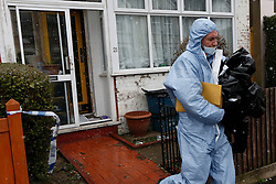 © Licensed to London News Pictures. 04/04/2013, London, UK.  A forensic officer leaves the house in Croydon, South London where a 67 year old man died after being taken ill after he arrived back home, Wednesday, to find his home was burgled, Thursday, April 4, 2013. Photo credit : Sang Tan/LNP