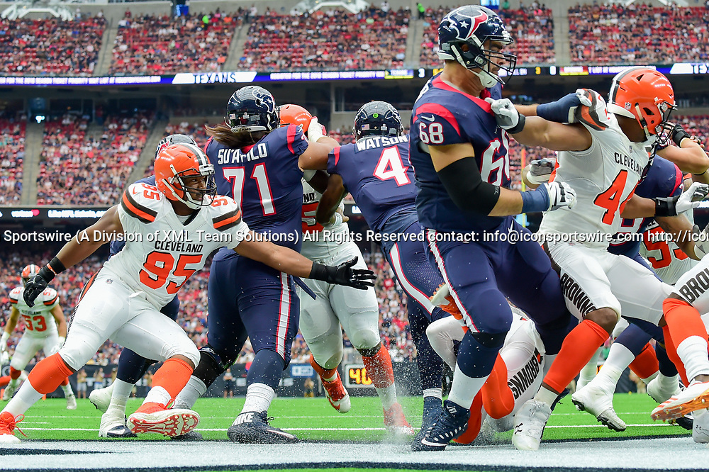 HOUSTON, TX - OCTOBER 15: Houston Texans quarterback Deshaun Watson (4) is scrambles to get loose from Cleveland Browns safety Briean Boddy-Calhoun (20) as Cleveland Browns defensive end Myles Garrett (95) closes in during the football game between the Cleveland Browns and the Houston Texans on October 15, 2017 at NRG Stadium in Houston, Texas. (Photo by Ken Murray/Icon Sportswire)