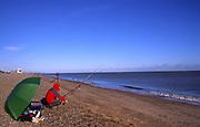 AWY76D Man fishing Aldeburgh beach Suffolk England