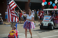 Holli Ratcliffe walks in the 4th of July parade in Oxford, Miss. on Thursday, July 4, 2013.
