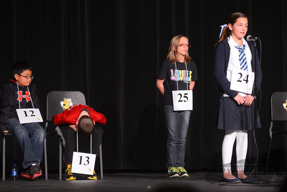 Gary Cosby Jr./Decatur Daily   Ashley Tate from Sparkman Elementary waits for her turn behind Zoey Crawford from Barkley Bridge Elementary during the Morgan County Spelling Bee at Hartselle High School Thursday afternoon.