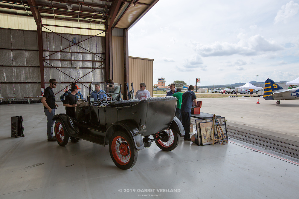 McPherson students ready their Model T for disassembly at the Santa Fe Airport, in anticipation of the 2012 Santa Fe Concorso events.