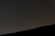 Salisbury Mills, New York  - Stars, including the constellation Orion, shine above Schunnemunk Mountain on the night of Sept. 29, 2013.