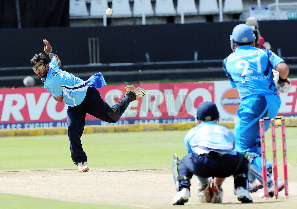 Ronnie Hira bowling during match 8 of the Karbonn Smart CLT20 South Africa between The Titans and The Auckland Aces held at Kingsmead Park in Durban, South Africa on the 17th October 2012..Photo by Gerhard Duraan/SPORTZPICS/CLT20
