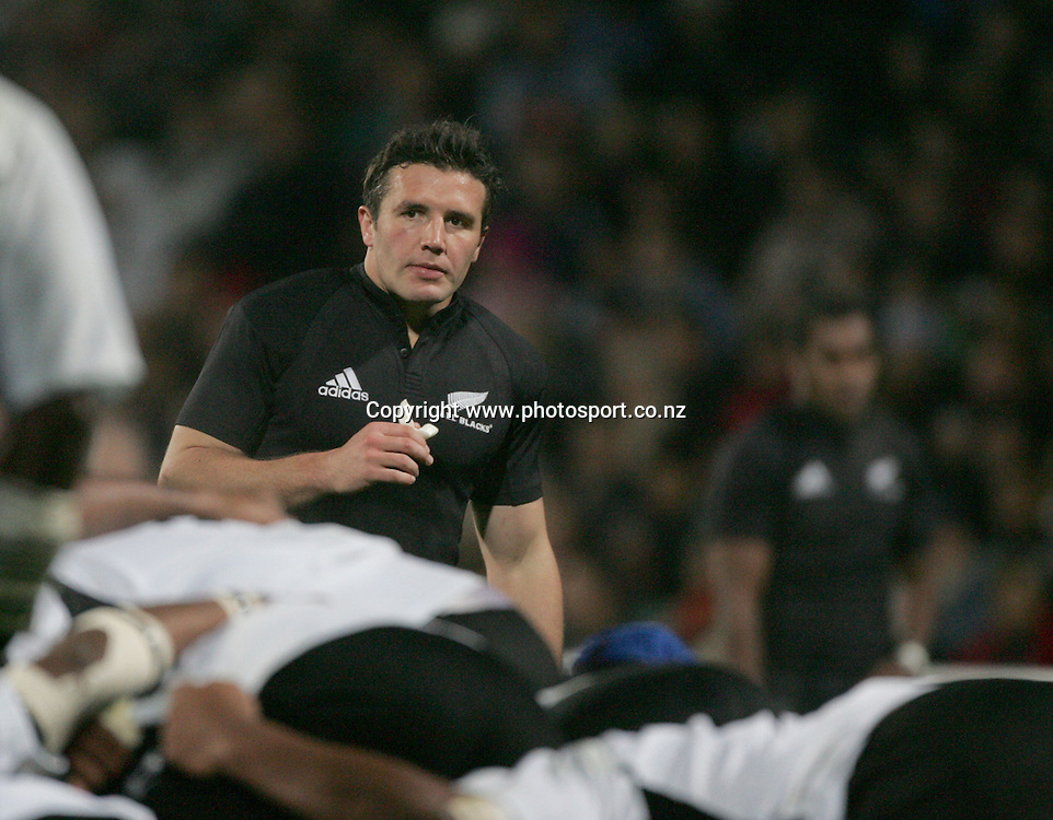 All Black centre Aaron Mauger waits for the ball during the All Blacks v Fiji Test match played at Albany Stadium, New Zealand, on Friday 10 June, 2005. The All Blacks won the match 91-0. Photo: Andrew Cornaga/PHOTOSPORT<br /><br /><br />126888