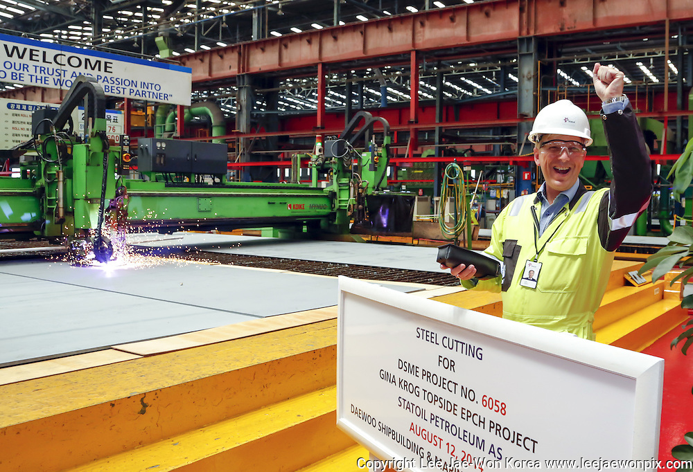 Frode Haldorsen, project manager for Gina Krog Topside Project of Statoil presses start button for the first plate cutting during a steel cutting ceremony for the project at Bay 3 cutting shop at Okpo shipyard of Daewoo Shipbuilding and Marine Engineering (DSME) in Geoje, about 470 km (292 miles) southeast of Seoul, South Korea, August 12, 2014. Photo by Lee Jae-Won (SOUTH KOREA)  www.leejaewonpix.com