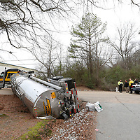 Thomas Wells | BUY at PHOTOS.DJOURNAL.COM<br /> Tupelo Police and Firemen secure the scene of a tractor trailer overtun on South Veterans Thursday morning. The trailer had to be offoaded and secured before wrecker crews could turn it over. There were no injuries.
