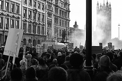 """© under license to London News Pictures. 26/11/2010 Spirit of the revolution. Photography student Patrick O'brien photographed the student protests in Whitehall, London, on Wednesday 24 Nov 2010. Unlike most students Patrick doesn't rely on digital cameras or even an iPhone. He managed to capture the spirit of the protests, using one of his collection of over 60 old film cameras. Once developed, his grainy images conjure up memories of many of the  protest pictures of the 60's and 70's.  ..Patrick, aged 21, used his trusty Leica M5 from 1972 with a 50mm lens with only 3 rolls of rollei retro 400s film. Once he captured the action, he then rushed home and developed the films in his bedroom , where he has a darkroom. Once the negatives were dry he scanned them digitally and published them on his website and used them in his studies...Patrick says """"My experience of the protest was a good one but at times there was a very tense atmosphere. I was always on my guard because of flying projectiles and constant crowd surges. Although I was aware of this it didn't stop me from taking my pictures. The pictures of Josef Koudelka in 1968 really influence my work. I really hope my pictures tell a slightly different story to that of digital cameras"""""""