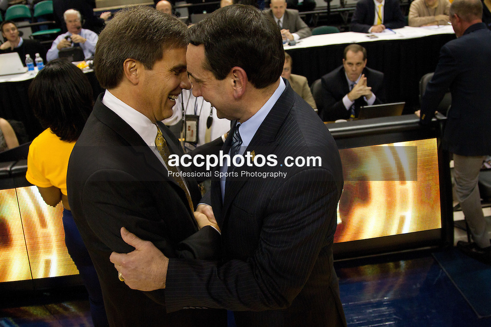GREENSBORO, NC - DECEMBER 29: Duke Blue Devils head coach Mike Krzyzewski talks with head coach Mike Dement the UNC-Greensboro Spartans post game on December 29, 2010 at the Greensboro Coliseum in Greensboro, North Carolina. Duke won 108-62 and with the win Mike Krzyzewski became the second all-time winningest Division I college basketball coach at 880 wins. (Photo by Peyton Williams/Getty Images) *** Local Caption *** Mike Krzyzewski;Mike Dement