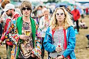 Serious visitors watching bands. The 2015 Glastonbury Festival, Worthy Farm, Glastonbury.
