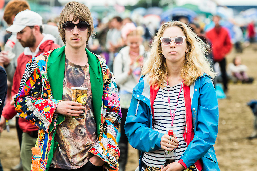 Serious visitors watching bands. The 2015 Glastonbury Festival, Worthy Farm, Glastonbury.